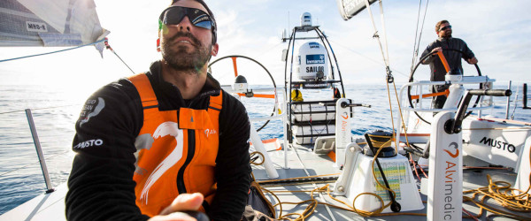 November 4, 2014. Leg 1 onboard Team Alvimedica. Day 24. With just 650 miles to Cape Town, the sailing slows considerably as a high-pressure system moves in from the west. The South Atlantic sun warms the crew, Mark Towill (L) and Charlie Enright (R), but it does nothing to help progress towards Cape Town in the light winds.